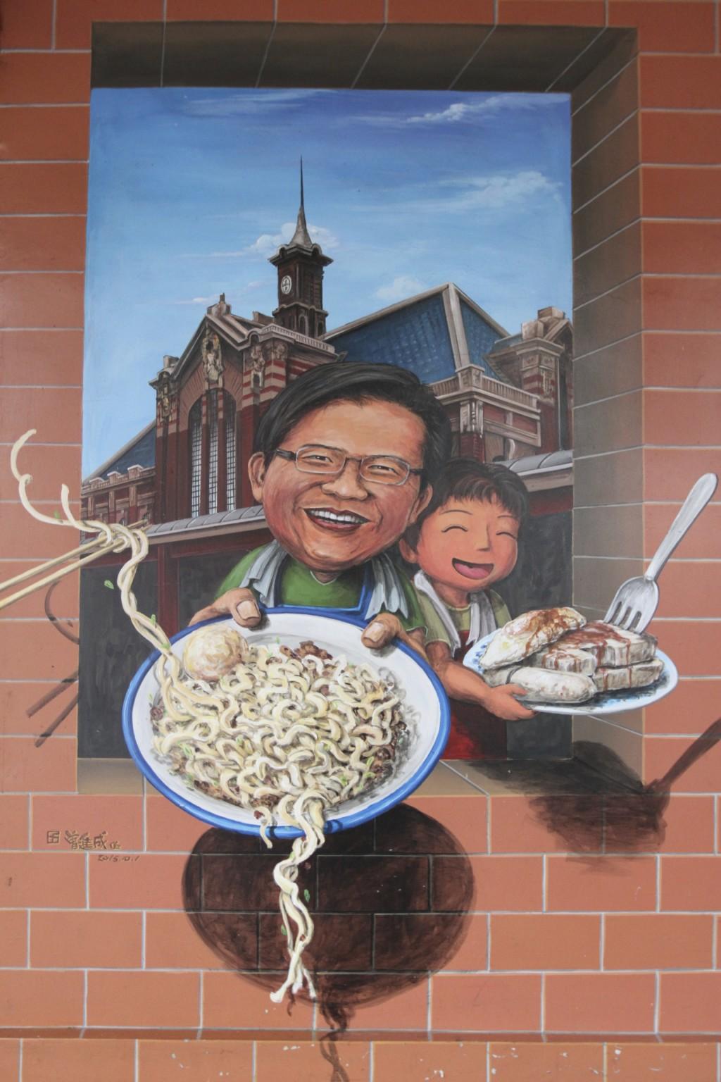 市場の壁に描かれたイラスト。背景は、台中駅だ